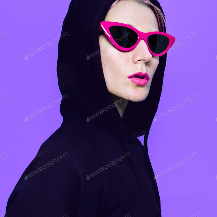 Blonde Girl in fashion sunglasses and hoody. Urban Street Outfit