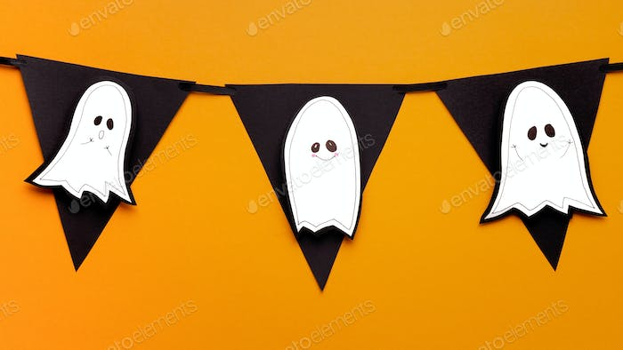 Close up of cute paper handicraft ghosts on black garland