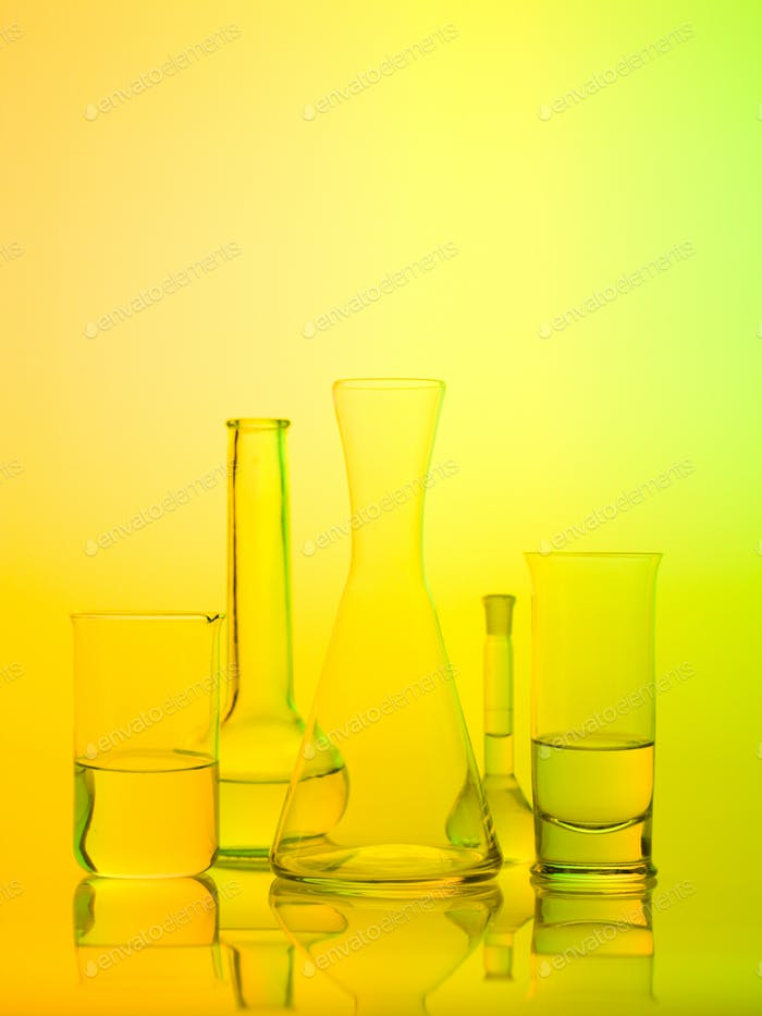 laboratory glass recipients on yellow background