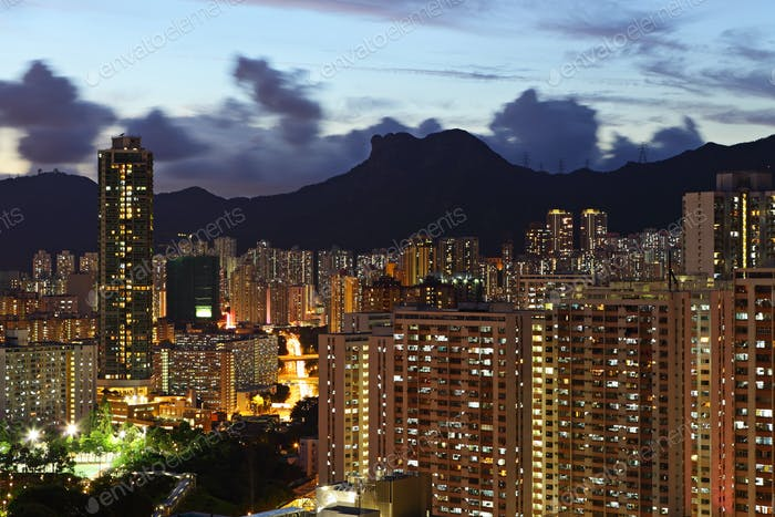 crowded building at night in hong kong