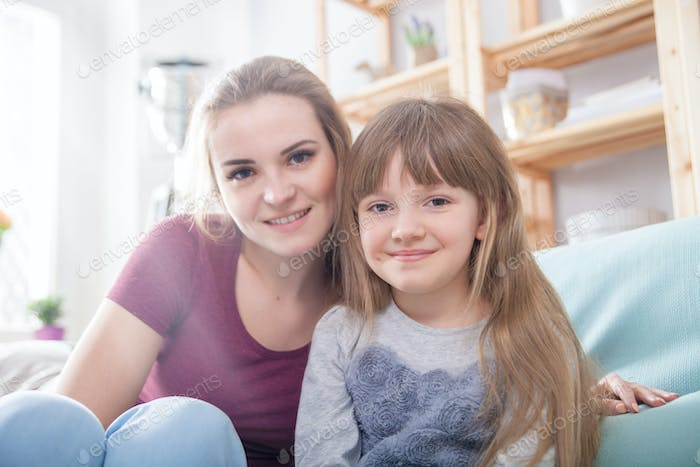 Mother and daughter at home, happy loving family