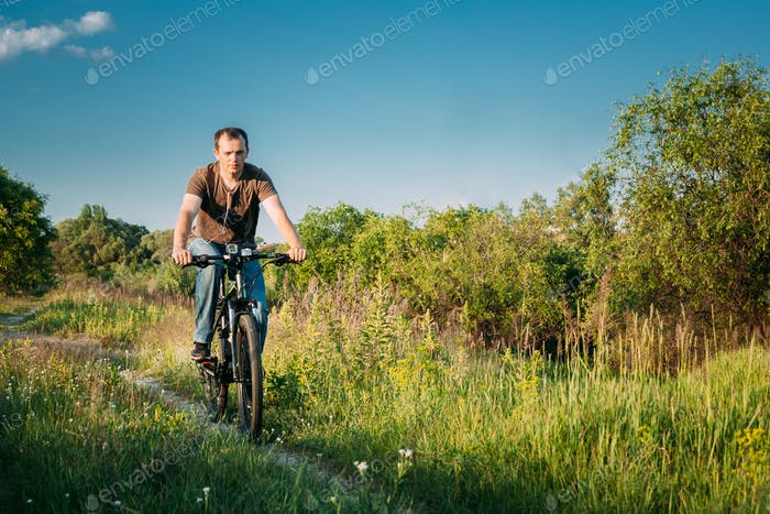 Man On Bike Bicycle Cycling  In Green Summer Sunny Park