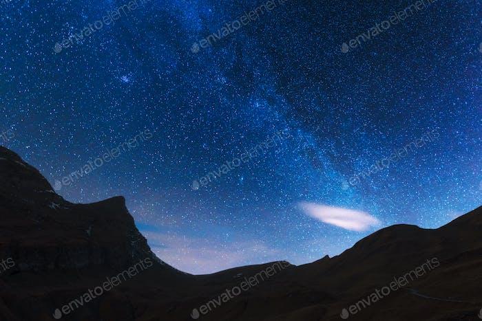 Incredible night view of Milky Way in blue sky