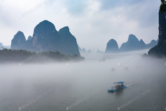 view of fog with ships on river near Xingping town