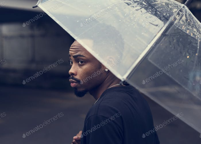 African descent man in an umbrella
