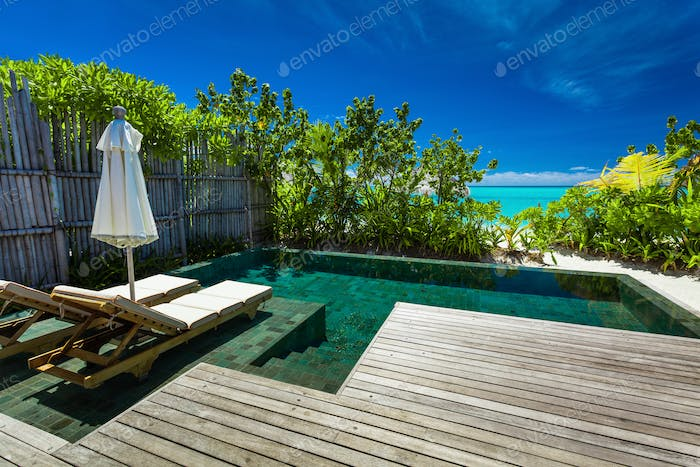 Private swimming pool on beach with amazing view of the ocean