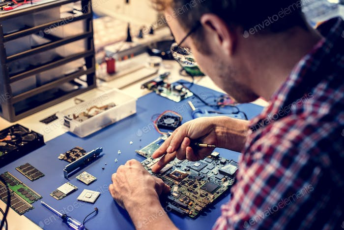 Technicians working on computer mainboard