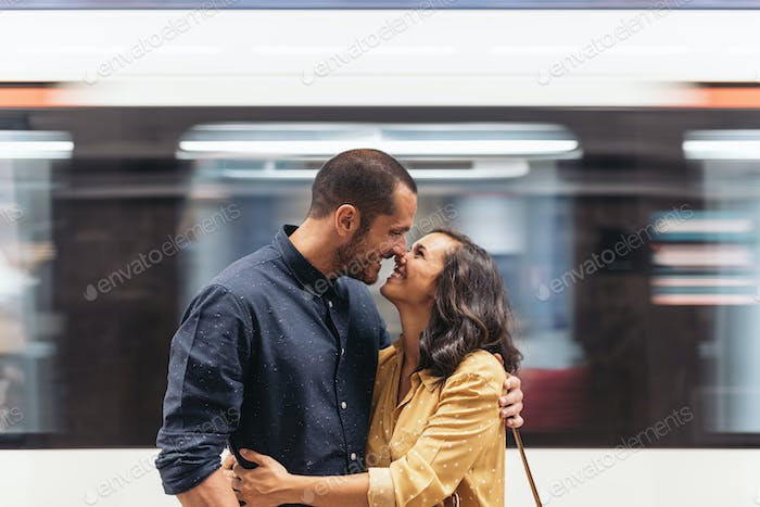 Smiling couple of lovers kissing.