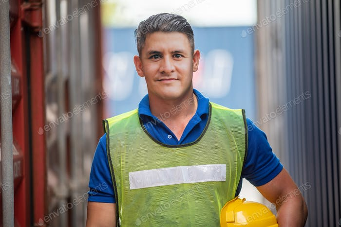 Portrait of foreman worker standing at Container cargo harbor to loading containers