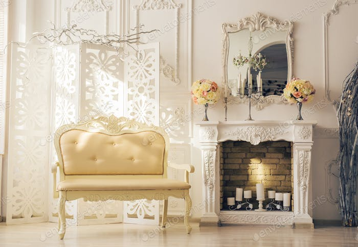Luxury interior of sitting room with old stylish vintage furniture.