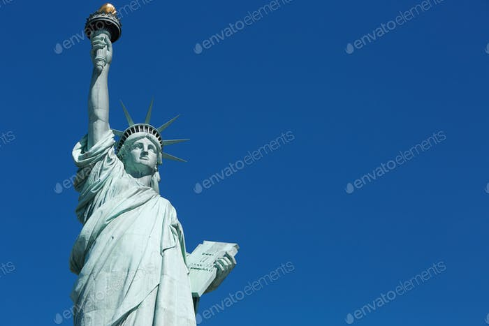 Statue of Liberty, blank blue sky space in New York