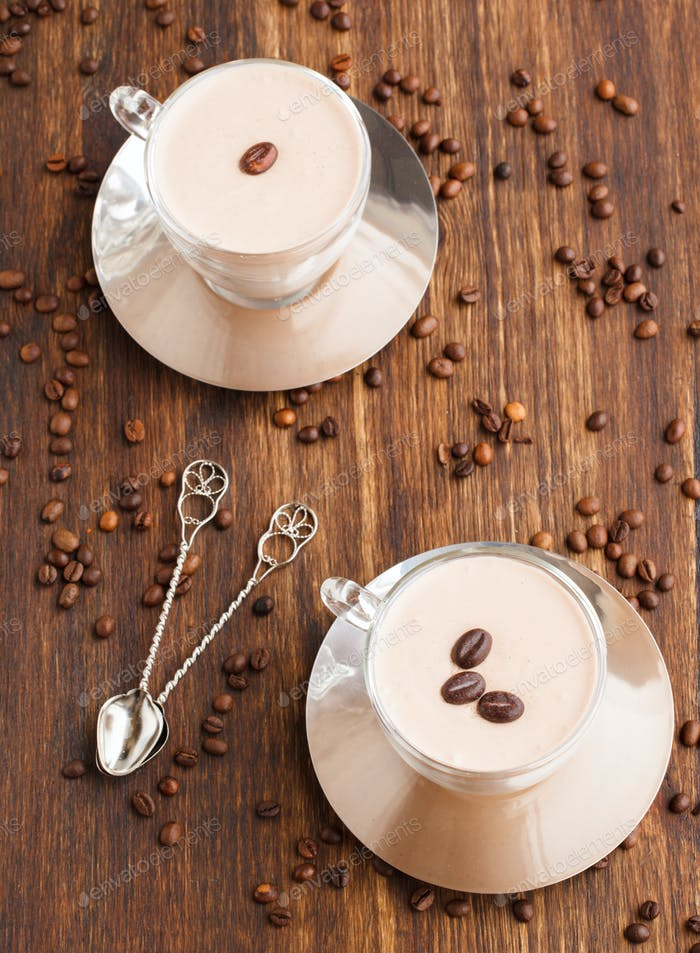 Coffee Panna cotta in a glass Cup with coffee beans.