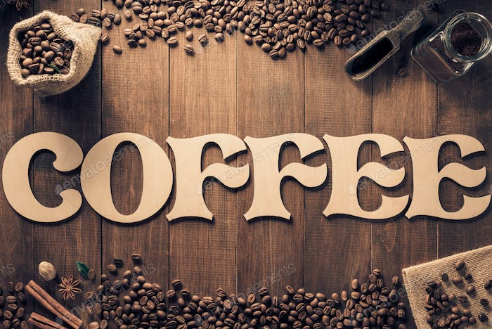 coffee letters and beans on wooden table