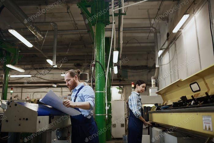 People working in printing plant