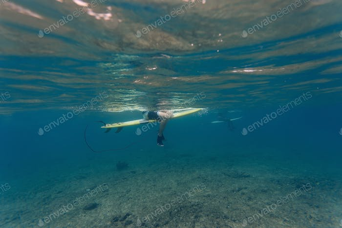 Surfer underwater view