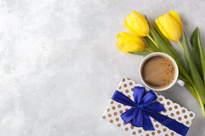 Flowers, gift box and coffee