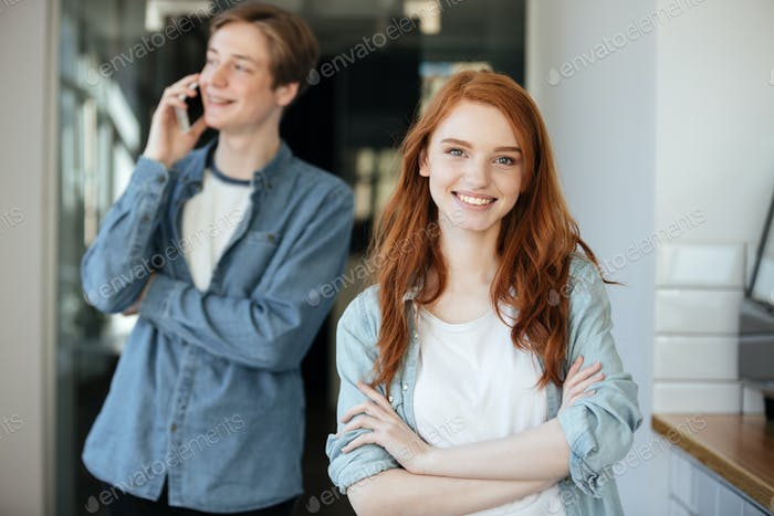 Portrait of redhead student in cafe