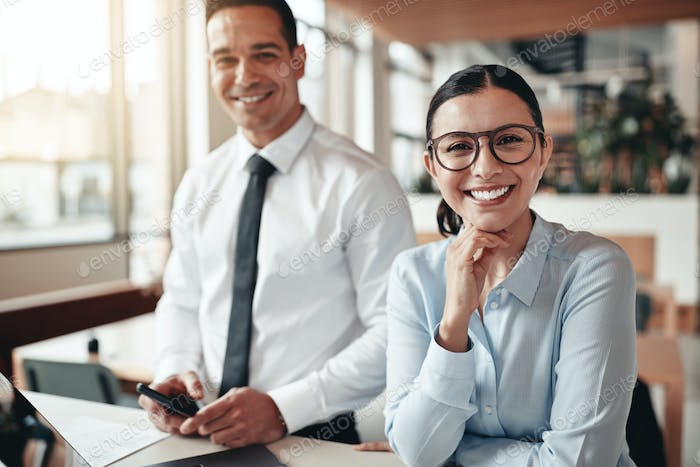 Smiling businesswoman working with a colleague in an office