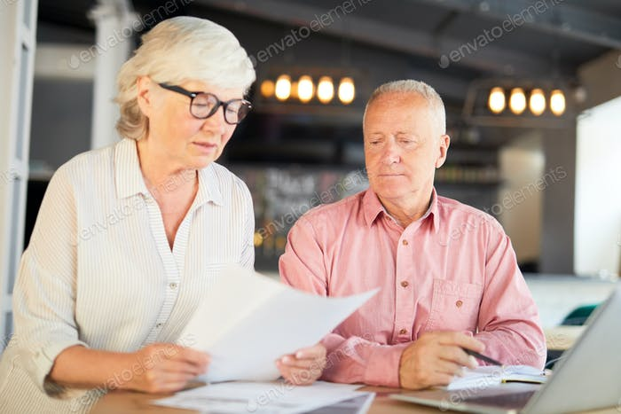 Accountants reading paper