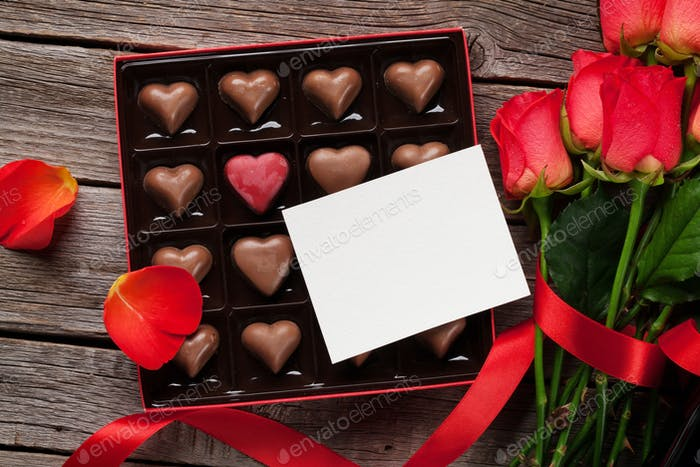 Valentines day with red roses and chocolate