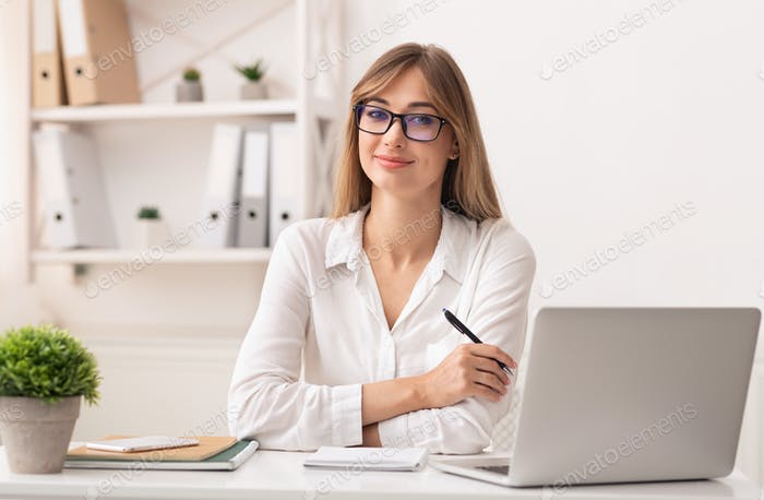 Confident Entrepreneur Lady Sitting At Laptop Working In Office