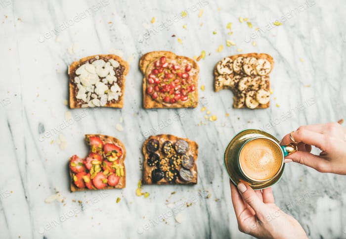 Healthy breakfast with wholegrain toasts , woman's hands with espresso