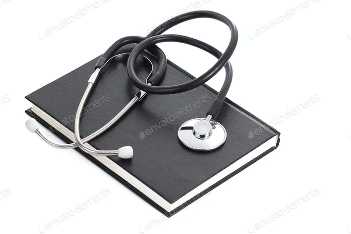book and stethoscope on white