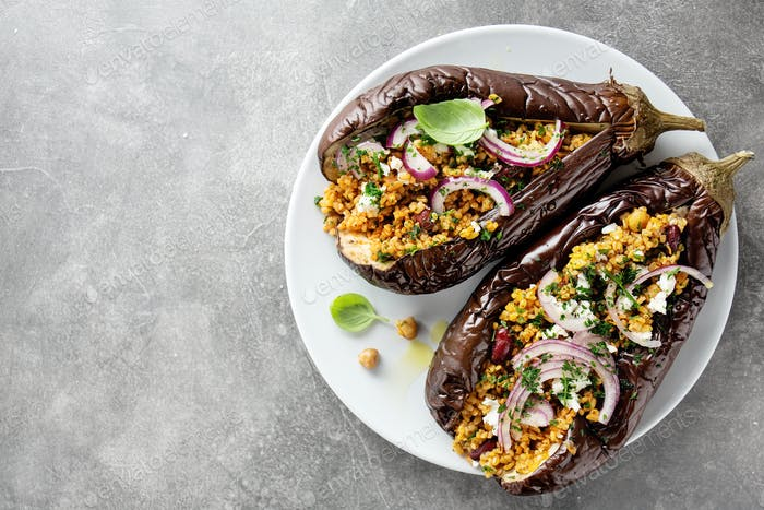 Baked aubergine with bulgur and feta