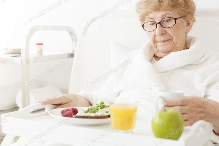 Elder eating meal at hospital