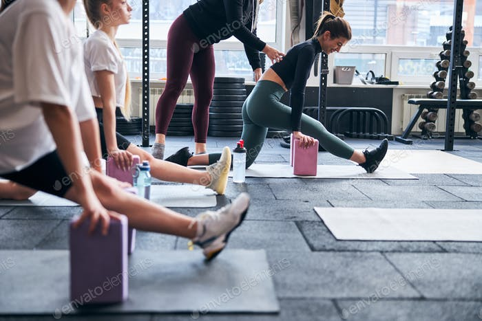 Fit flexible ladies preparing to do splits