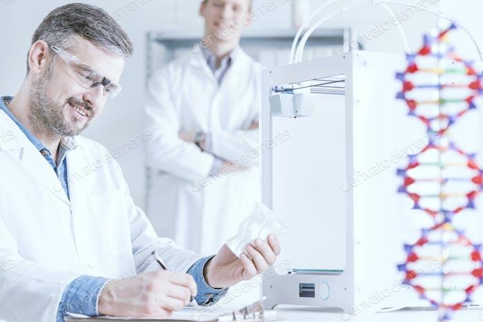 Scientist holding 3D printout