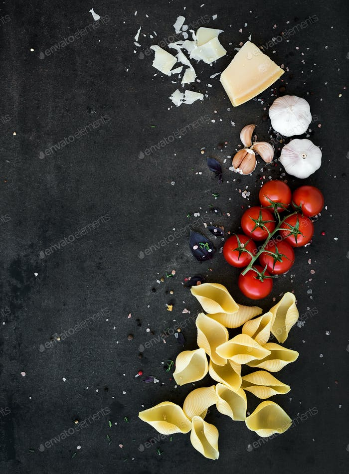 Food frame. Pasta ingredients. Cherry-tomatoes, pasta, garlic, basil, parmesan and spices