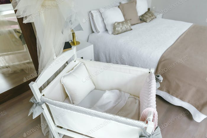 Bedroom with cot and double bed