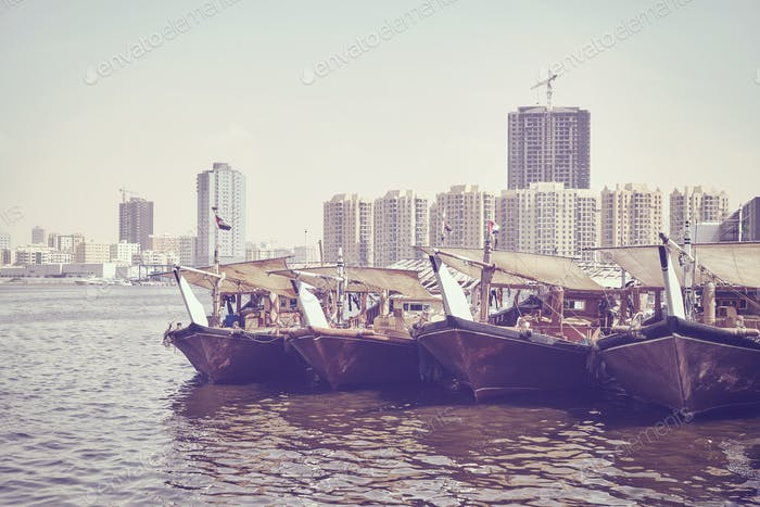 Fishing boats at Ajman fish market pier.