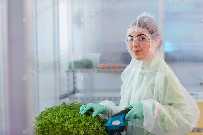 Woman cutting plants