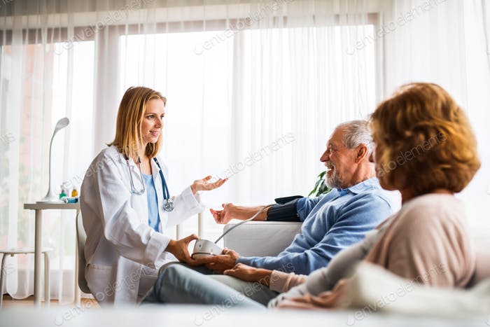 Female doctor checking blood pressure of senior man.