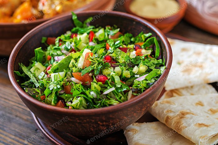 Fresh salsa salad with tomatoes, pepper,onions and herbs. Mexican vegetable salad. Vegan food.