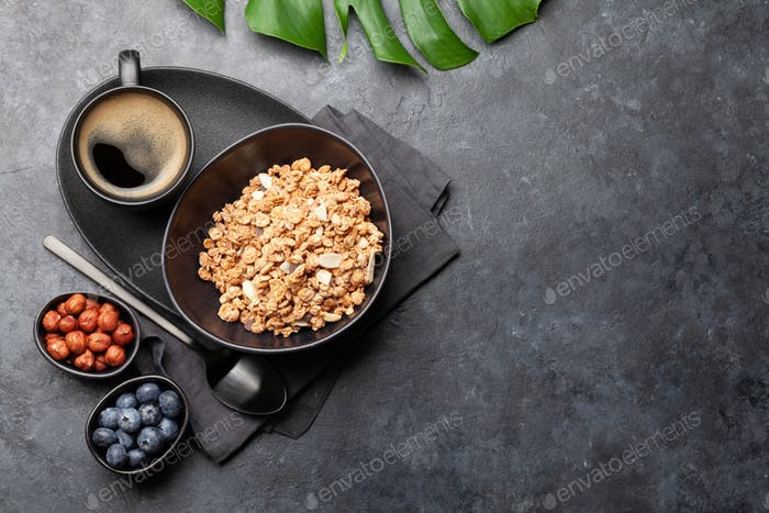 Healthy breakfast with granola, nuts and berries