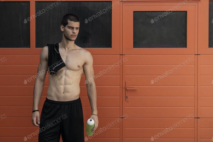 Muscled male model posing