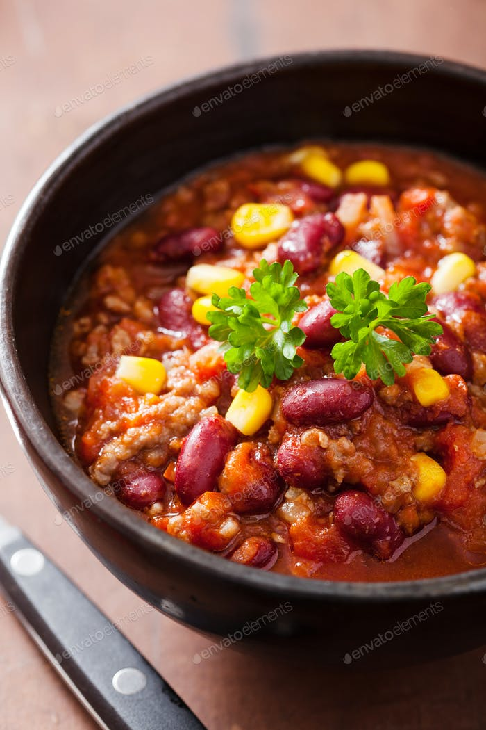 mexican chili con carne in black bowl