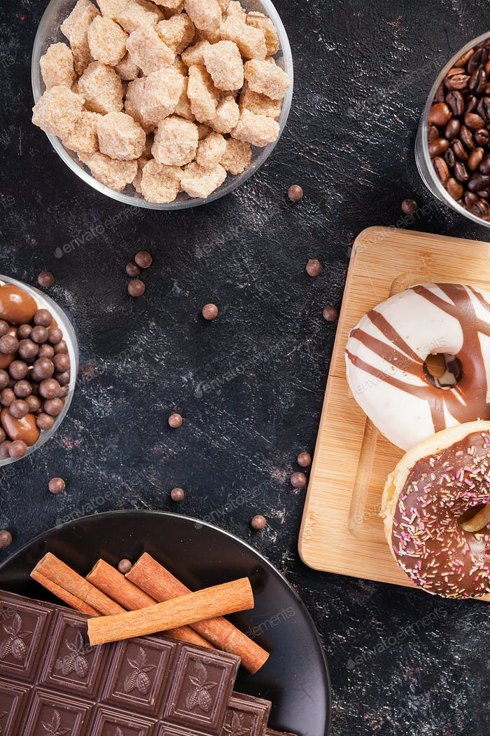 Candies, brown sugar, donuts and coffee