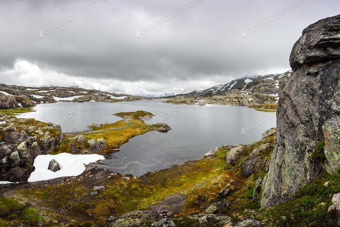 Amazing norwegian landscape with snowy mountains