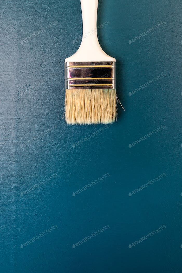Paint brush on a dark blue background. Free space for text.