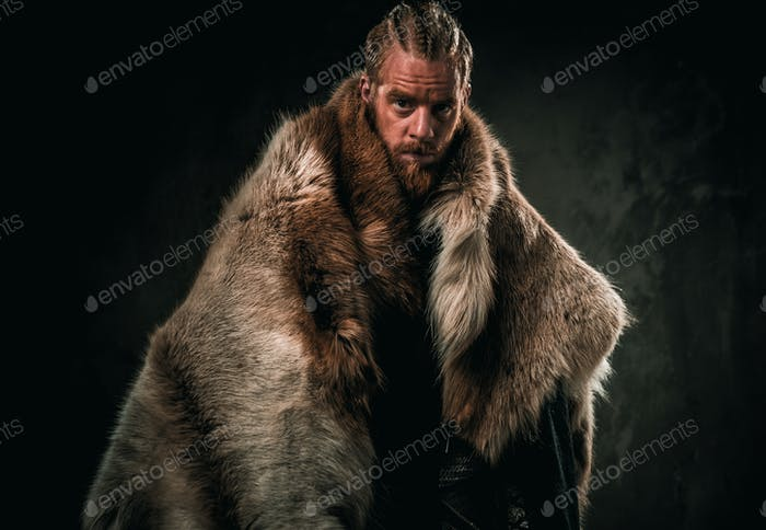 Viking konung in a traditional warrior clothes