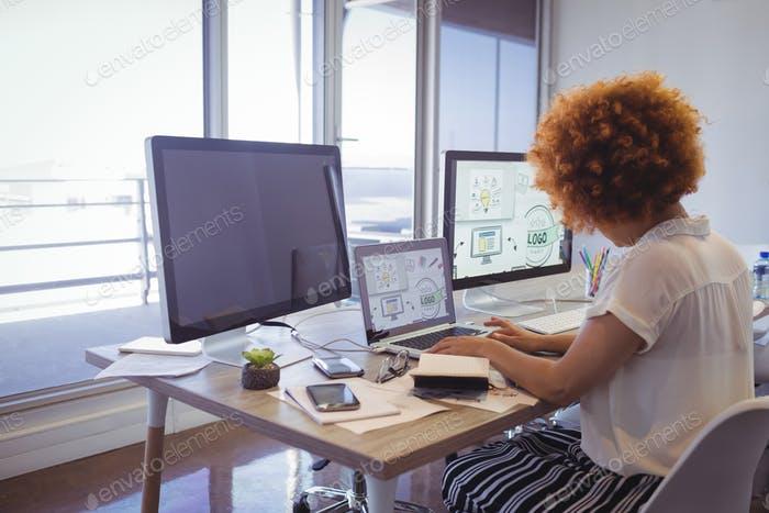 Focused businesswoman working in office