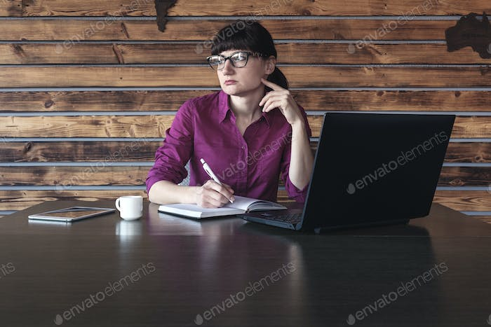 Worried woman thinking of problems during work