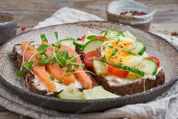 Smorrebrod - traditional Danish sandwiches. Black rye bread with