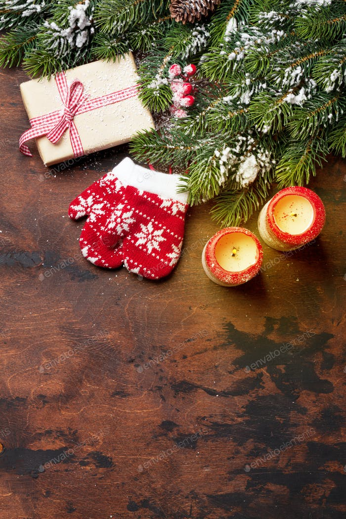 Christmas gift box, candles and fir tree branch