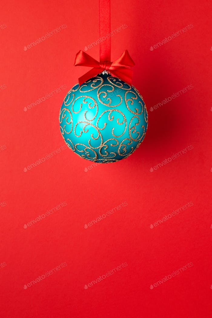 Christmas Ball Hanging on Red Ribbon.
