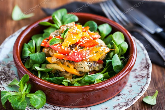 Delicious fresh warm eggplants, bell pepper and sesam salad